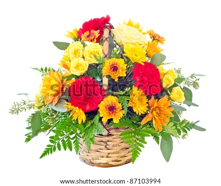 Flower arrangement with fall color carnations and daisies in basket - stock photo