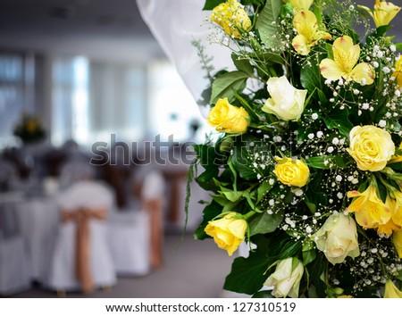 Flower arrangment in fancy restaurant - stock photo