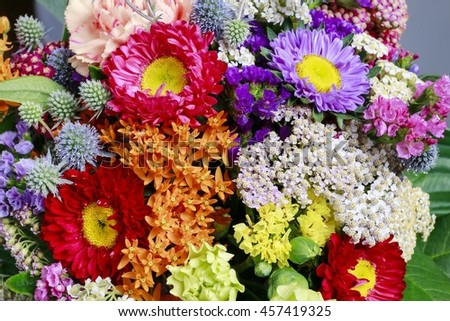 Flower background with chrysanthemum flowers and achillea twigs.  - stock photo