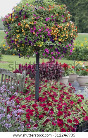 Flower basket tree on pole with bench