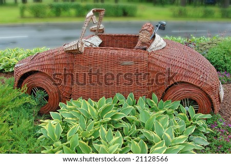 Flower bed in the form of the golf cart - stock photo
