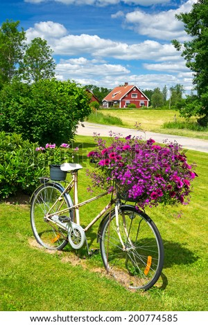 Flower bicycle in Swedish garden - stock photo