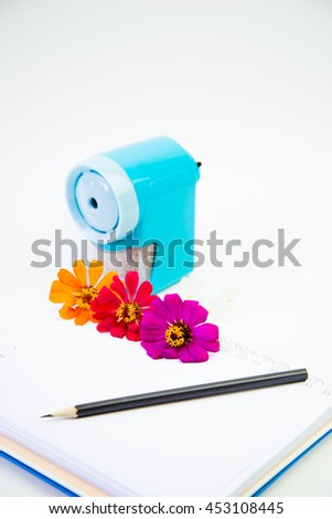 Flower Book and pencil placed on a white background. - stock photo