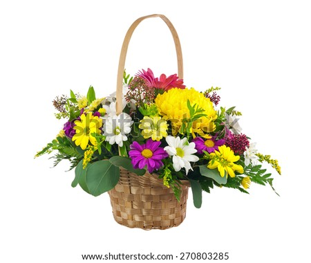 Flower bouquet from multicolored chrysanthemum and other flowers arrangement centerpiece in wicker basket isolated on white background. - stock photo