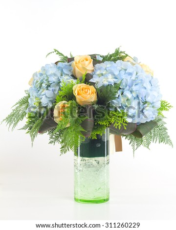 Flower bouquet in vase isolated. - stock photo