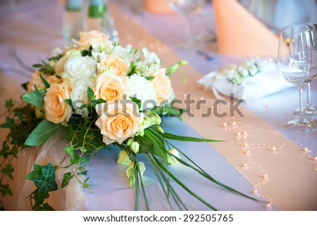 Flower bouquet  on wedding dining table - stock photo