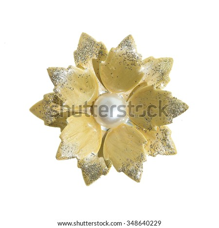 flower brooches on white background - stock photo