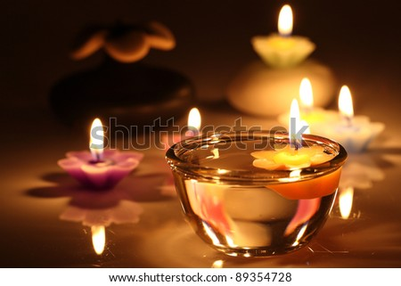 flower candles isolated in white background - stock photo