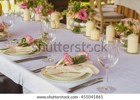 flower composition and candles in the restaurant. Wedding dinner