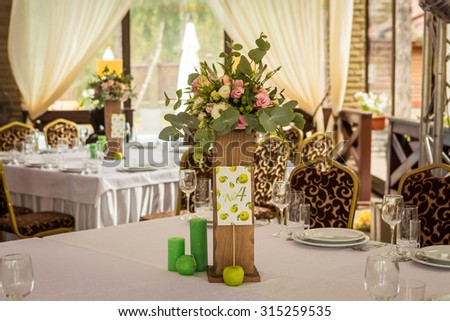 flower composition in the restaurant - stock photo