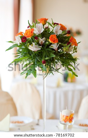 Flower composition made with orange roses and red gilly-flower - stock photo