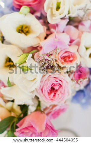 flower composition roses, hydragea and willow - stock photo
