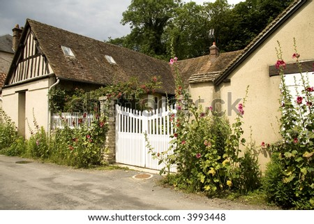 Flower covered Gate to a Farm in Normandy France - stock photo