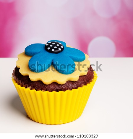 flower cupcake on a pink bokeh background
