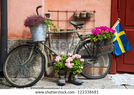 Flower Decorated military Bike In Defense area in Stockholm - stock photo