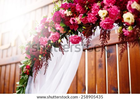 Flower decoration in wedding day. Pink, red and white roses and peony. Selective focus.