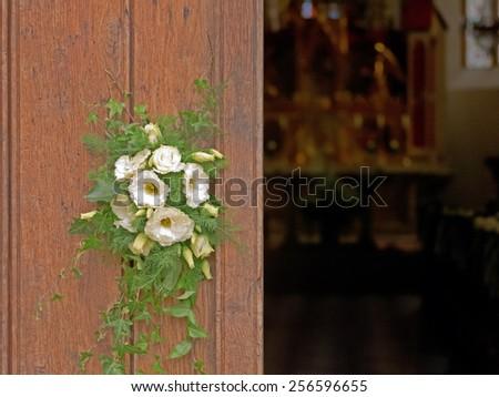 Flower decoration on a church door.  - stock photo