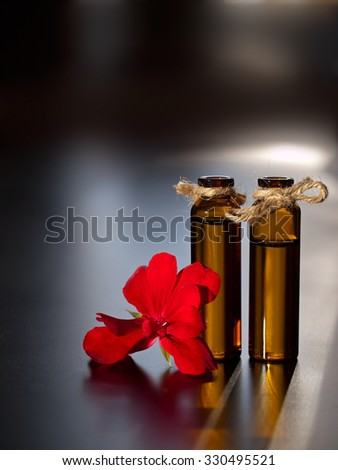 Flower essential oil for aromatherapy. - stock photo