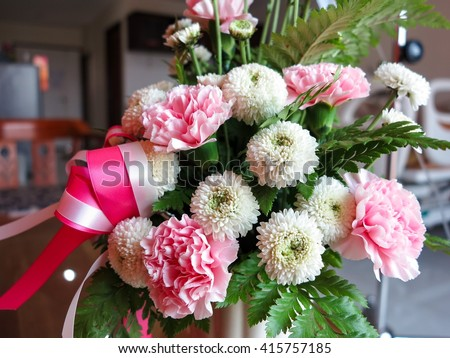 Flower for patient, selective focus on flower. - stock photo