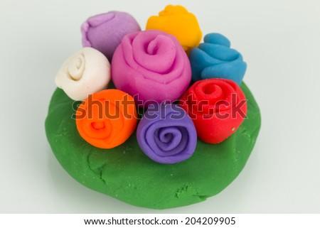 Flower from children bright plasticine - Stock Image macro. - stock photo