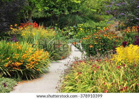 Flower Garden With Winding Path - stock photo