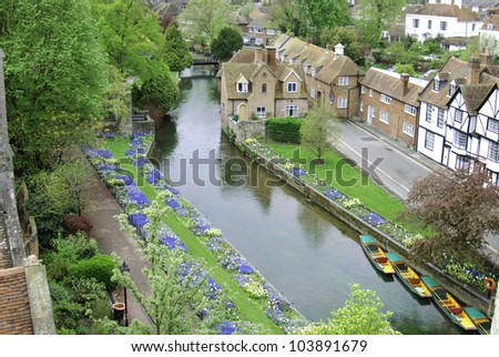 Flower gardens on the banks of the River Stour, Canterbury, Kent, UK - stock photo