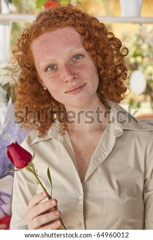 Flower gift: Woman holding a single rose