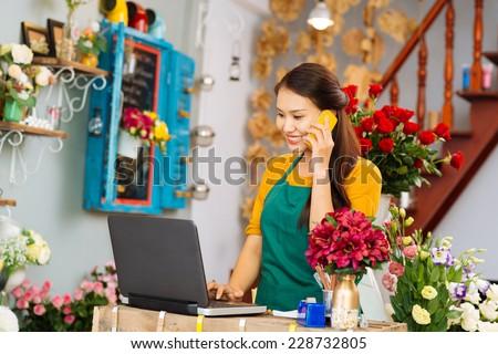 Flower girl taking an order - stock photo