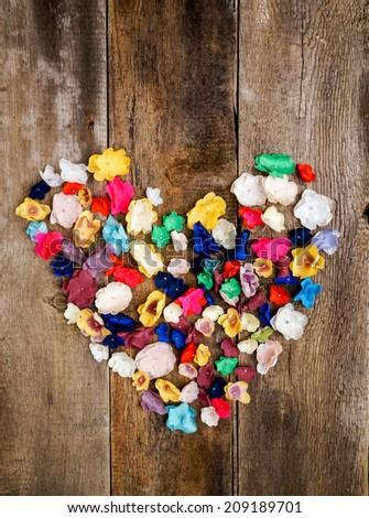 flower heart over dark brown wooden background - stock photo