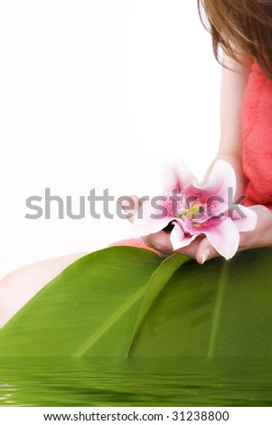 flower in a hand with petals in a water - stock photo