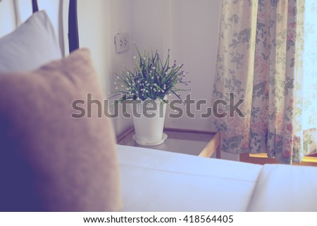 flower in a vase in the bedroom, vintage colors. - stock photo