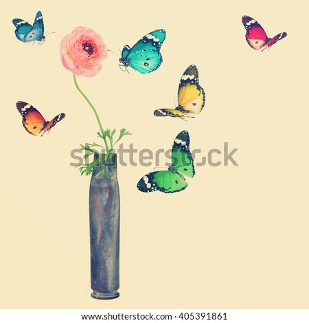 Flower in the cartridge case and colorful butterflies. Revival. Toned colors vintage style image - stock photo