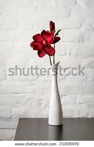 Flower in the white vase on the table - stock photo