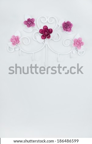 Flower iron hook for hanging clothes - stock photo
