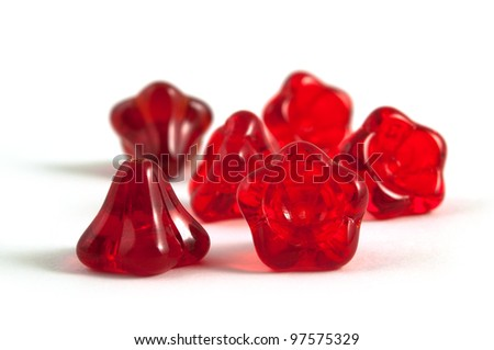 flower-like opaque red beads on white