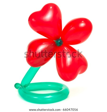 Flower made from vibrant twisted balloons isolated on white background. - stock photo