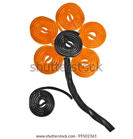 Flower made of liquorice spiral candies isolated on white background - stock photo