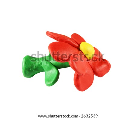 Flower made out of plasticine (isolated on white). - stock photo