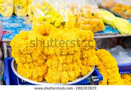 Flower market in Thailand,marigold garland at market - stock photo