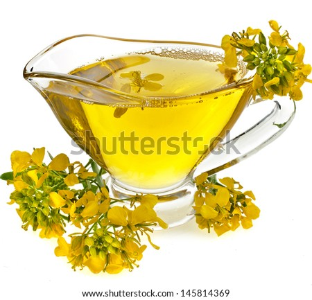 Flower mustard and Oil  in gravy boat isolated on white background  - stock photo