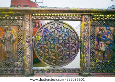 Flower of life design with paint splatter on bridge