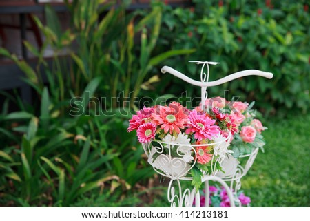 Flower on a bicycle background. - stock photo