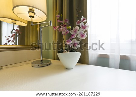 Flower on a table in the morning - stock photo