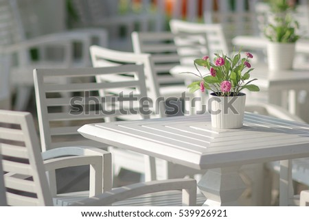 Flower on table in restaurant.