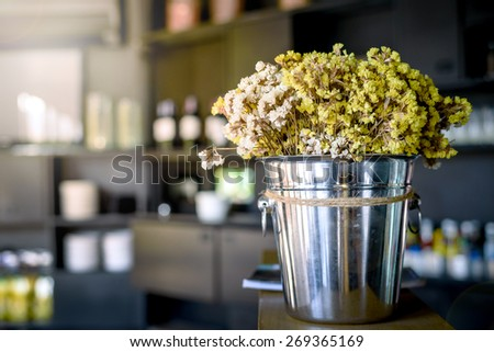 flower pot in a decorated room , vintage background - stock photo