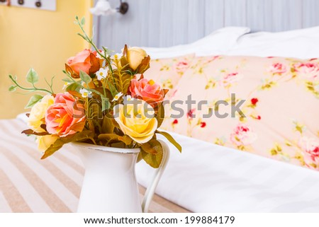 flower pot in decorated bedroom - stock photo