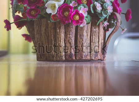 Flower pot on the wooden table - stock photo