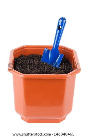 Flower pot with soil and shovel isolated on white - stock photo