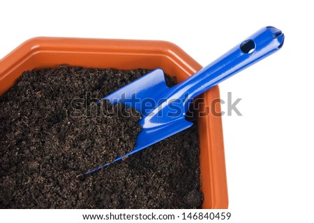 Flower pot with soil and shovel isolated on white close up - stock photo