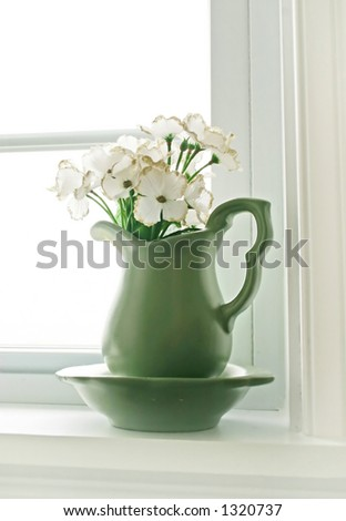 Flower Vase in Window - stock photo
